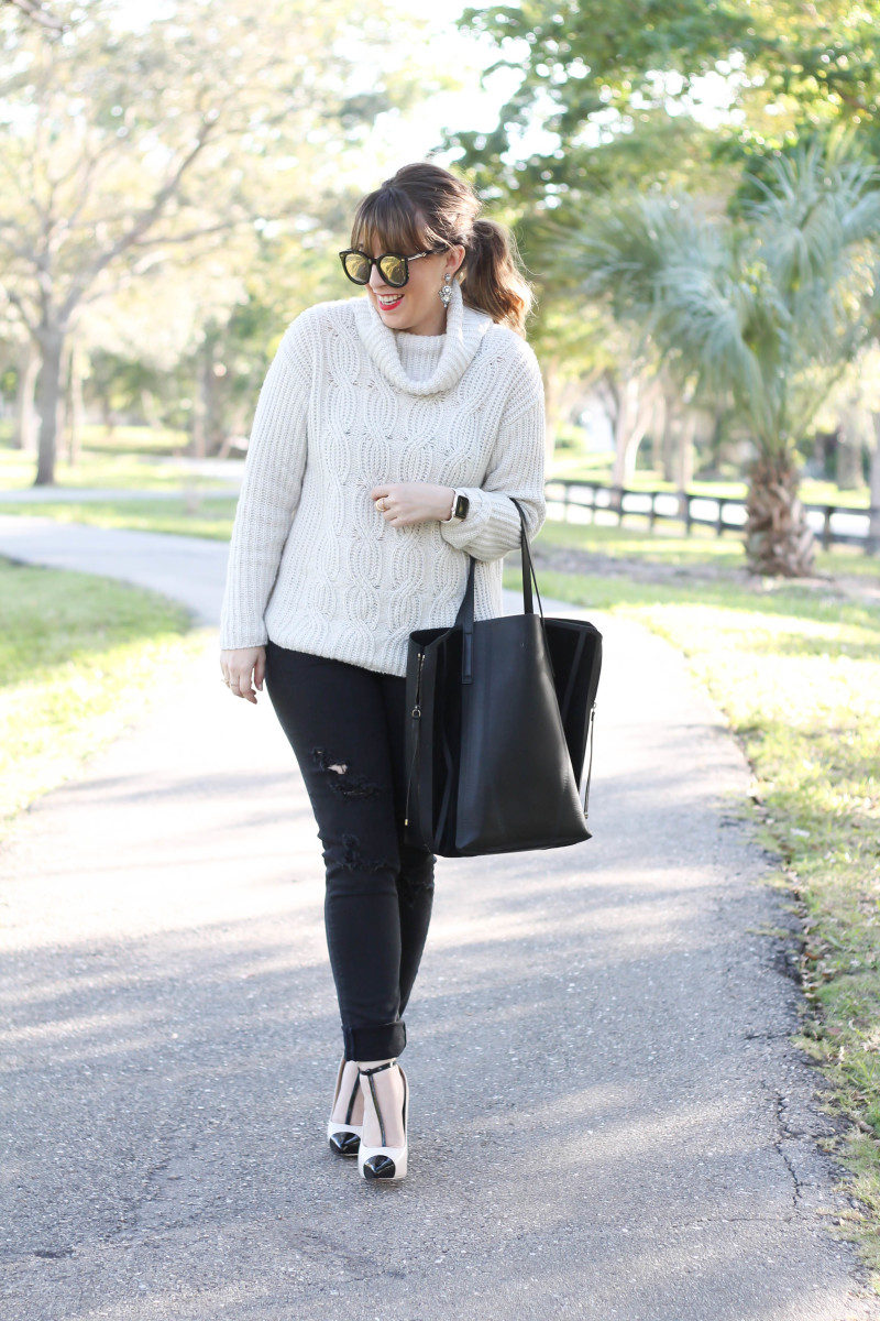 Turtleneck sweater, distressed black jeans, cap toe pumps
