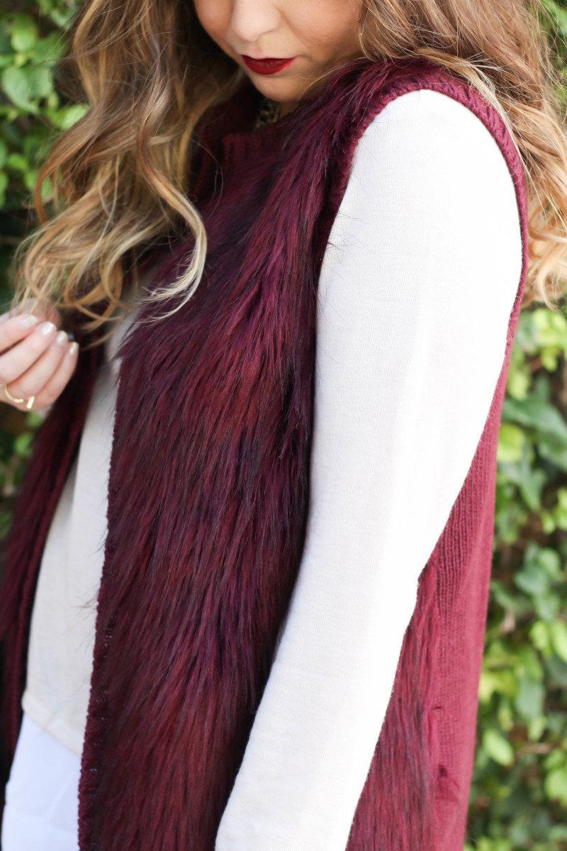 fur vest, layered sweater, leather leggings-10