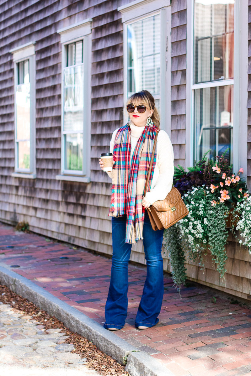 Miami fashion blogger Stephanie Pernas in Nantucket styling flare jeans with a turtleneck sweater