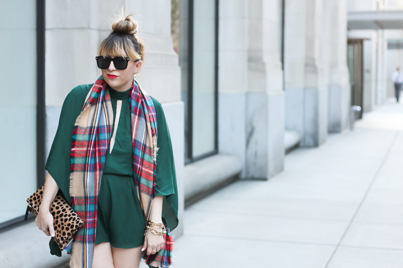 Miami fashion blogger Stephanie Pernas wears an emerald green Forever 21 romper with a plaid blanket scarf and over the knee boots.