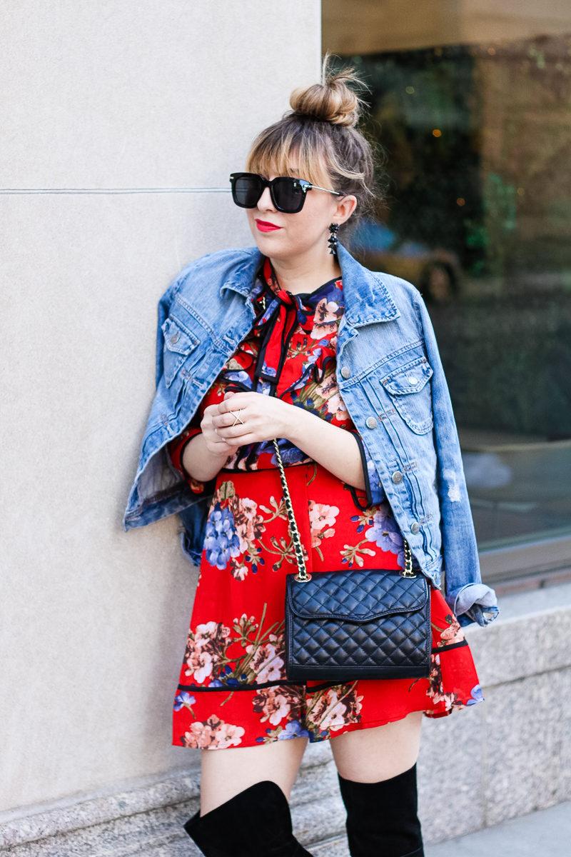 Miami fashion blogger Stephanie Pernas styles a jean jacket draped over a bow tie dress
