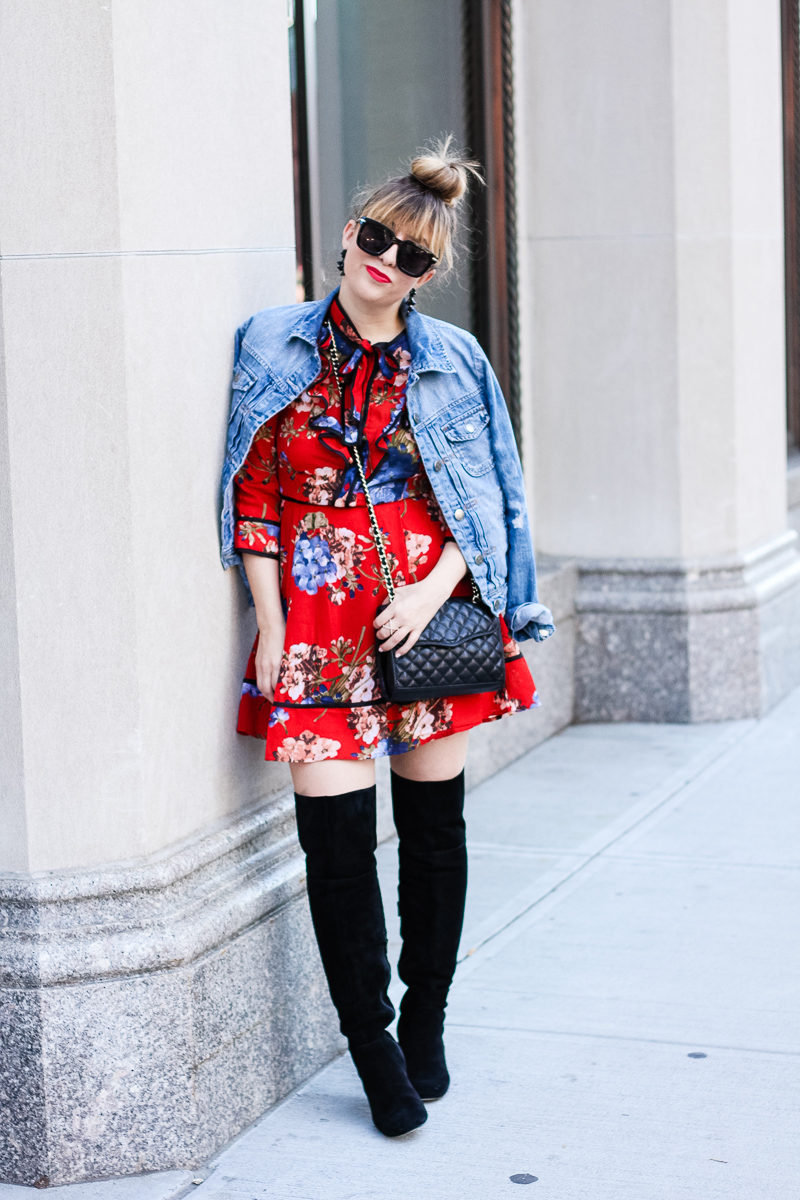 Miami fashion blogger Stephanie Pernas of A Sparkle Factor wearing a J. Crew Factory draped jean jacket over a Shopbop floral print dress with Sole Society Leandra boots for a chic fall look
