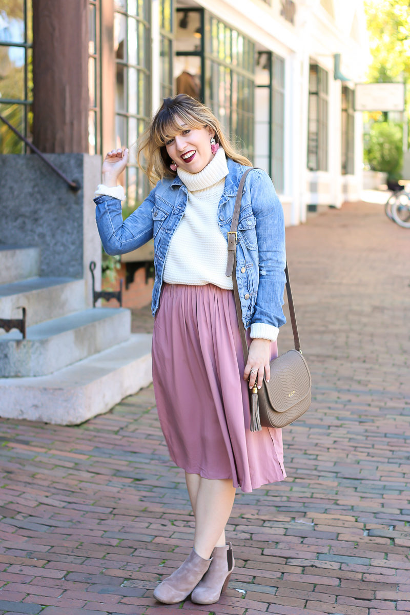 Miami fashion blogger Stephanie Pernas wearing a jean jacket with a turtleneck sweater and midi skirt.