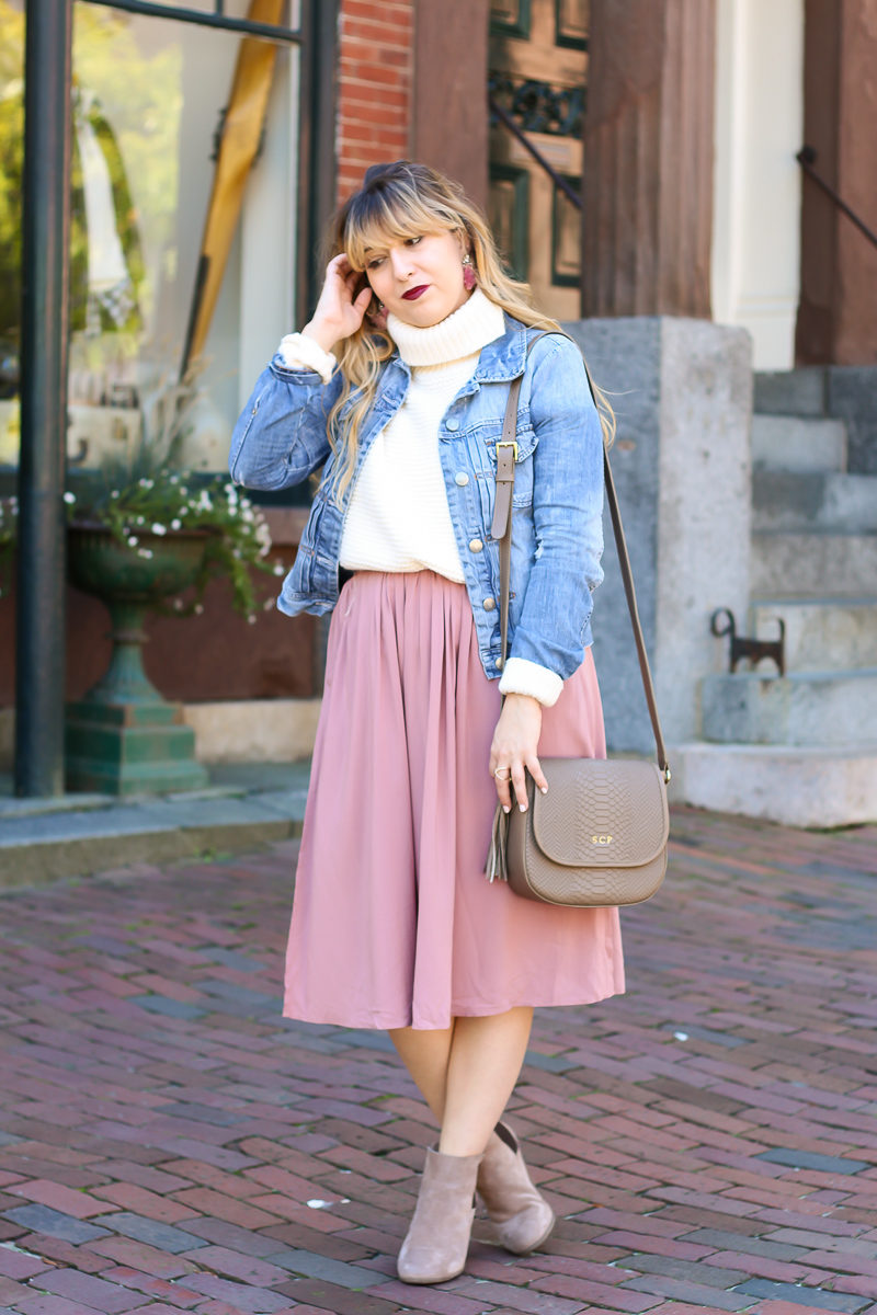 Miami fashion blogger Stephanie Pernas styles a midi skirt with a turtleneck sweater and booties for an easy fall outfit idea.