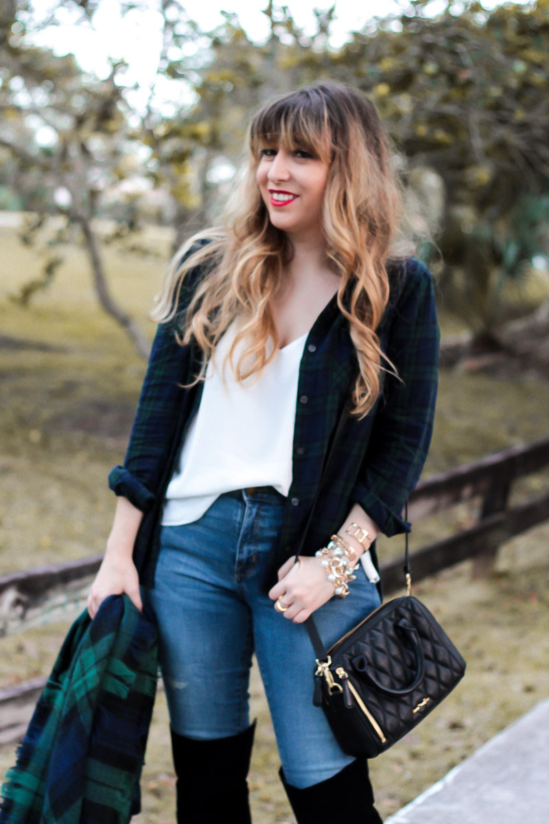 Miami fashion blogger Stephanie Pernas layers a plaid button down over a camisole and jeans for an easy fall outfit idea