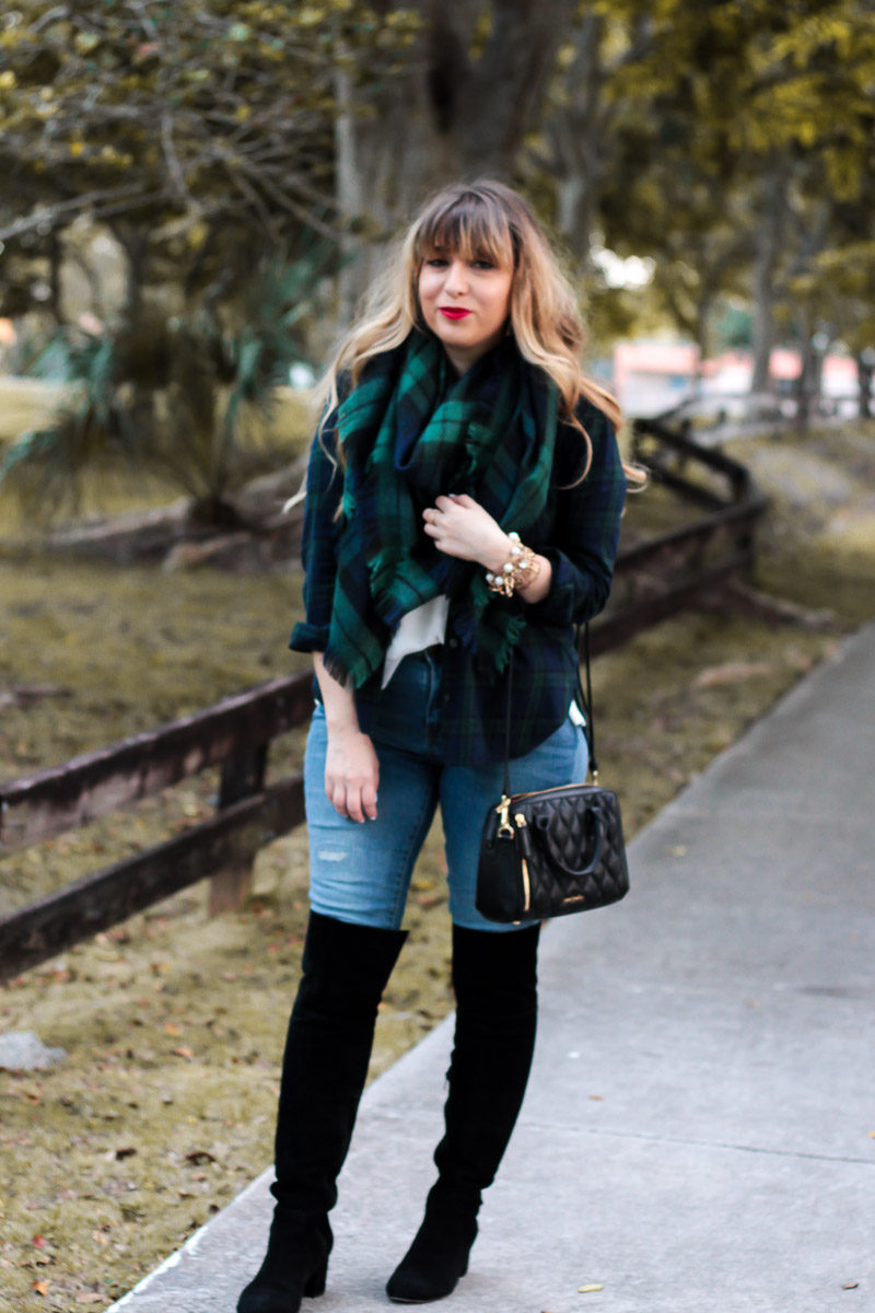 Miami fashion blogger Stephanie Pernas styles a casual holiday plaid outfit idea around the Sole Society Leandra over the knee boots and a cozy plaid blanket scarf with jeans