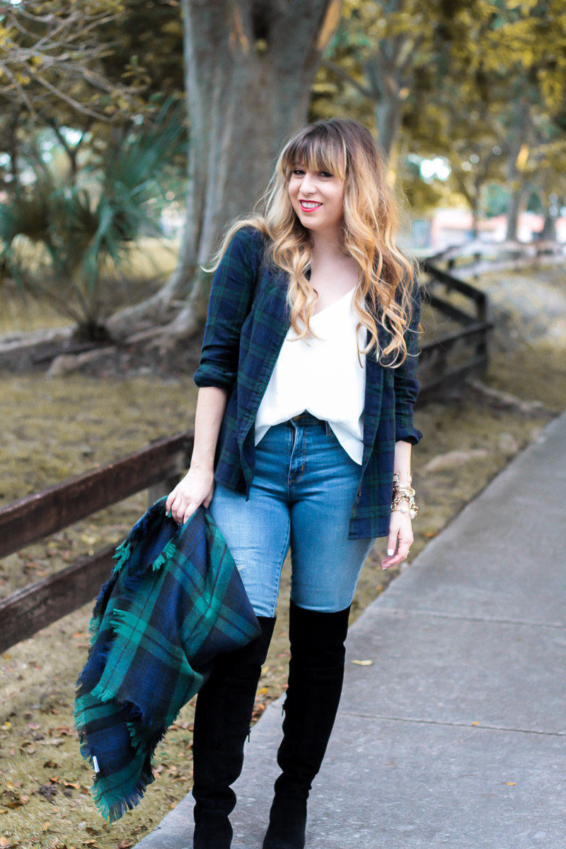 Fashion Blogger Stephanie Pernas wears black over the knee boots with jeans and a cozy blanket scarf