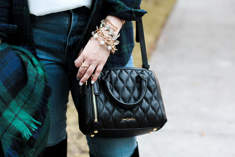 Miami fashion blogger Stephanie Pernas styling a chic bracelet stack and blanket scarf