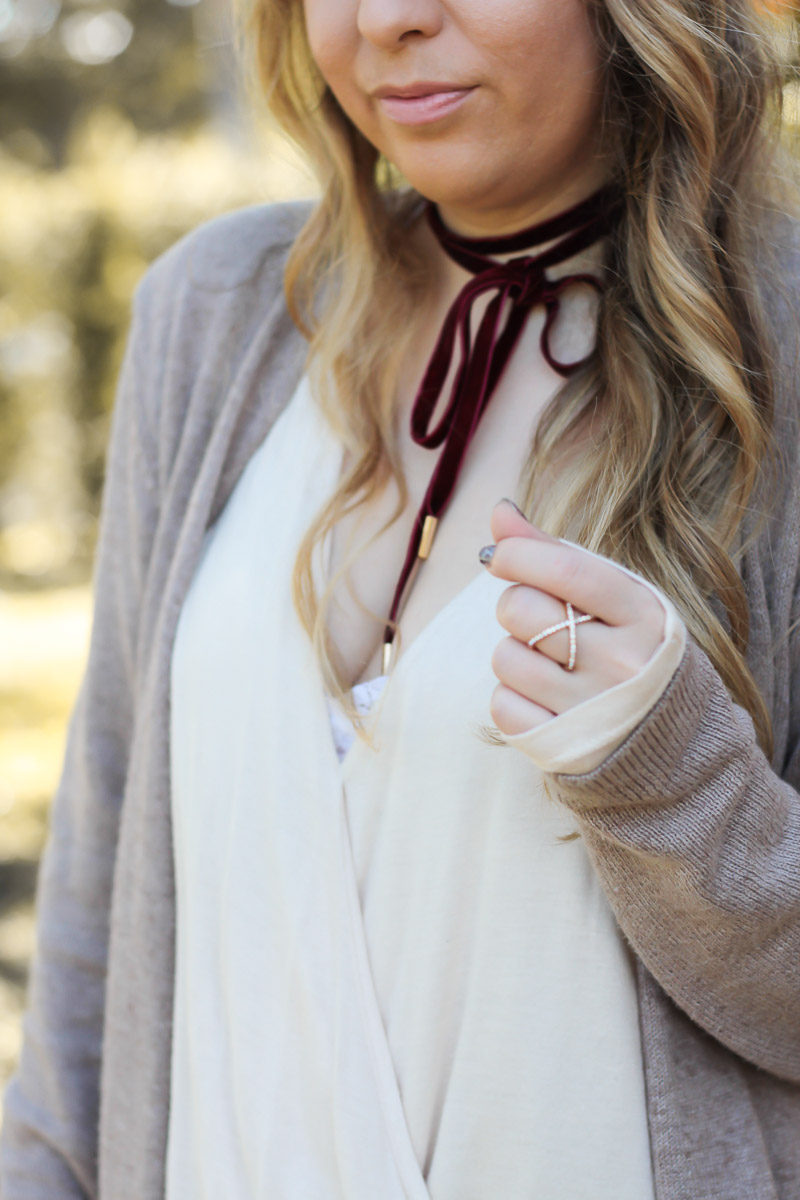 Miami fashion blogger Stephanie Pernas styles a burgundy velvet choker with a cozy cardigan