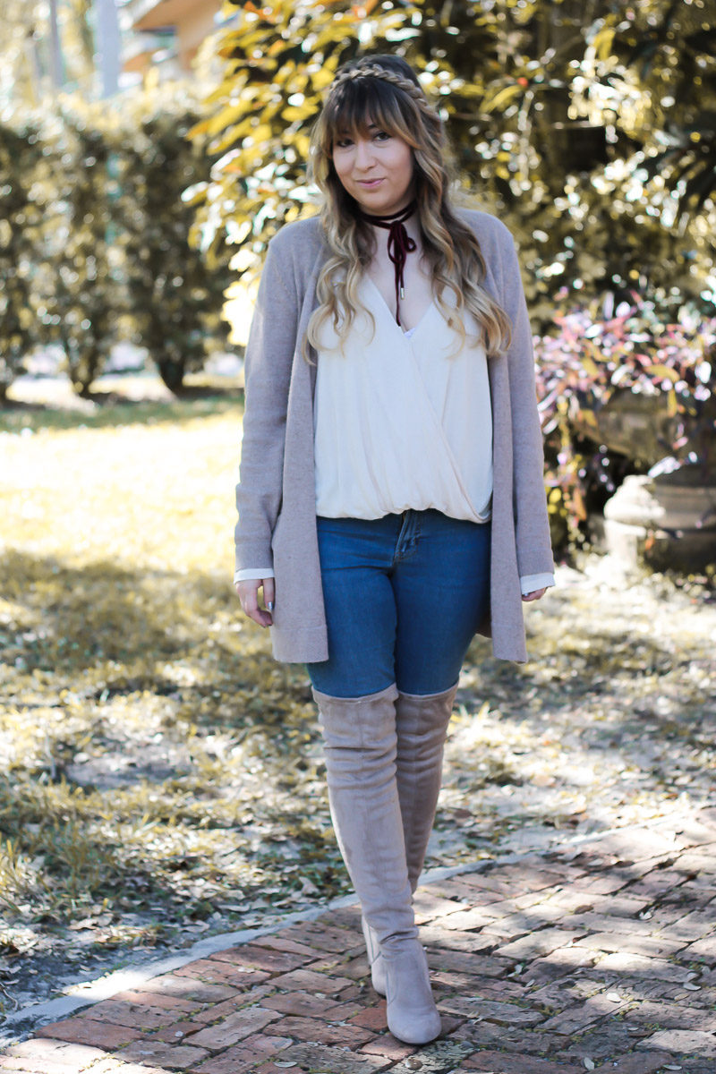 Miami fashion blogger Stephanie Pernas styles a cozy Thanksgiving outfit idea with an oversized Old Navy cardigan and Chinese Laundry over the knee boots.