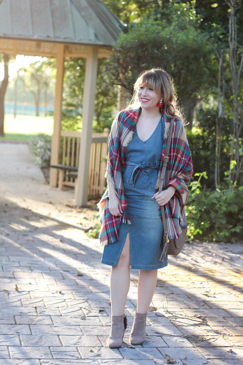 Miami fashion blogger Stephanie Pernas wearing a denim dress and plaid blanket scarf