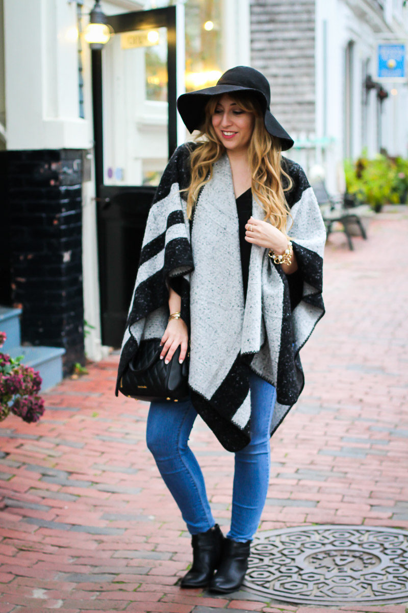 Miami fashion blogger Stephanie Pernas styles a cozy poncho with jeans and booties for an easy fall outfit idea.