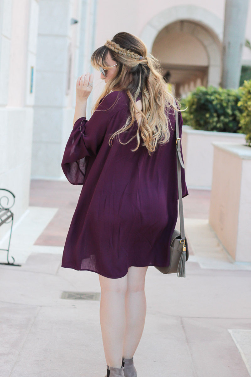 Miami fashion blogger wearing a plum bell sleeve shift dress