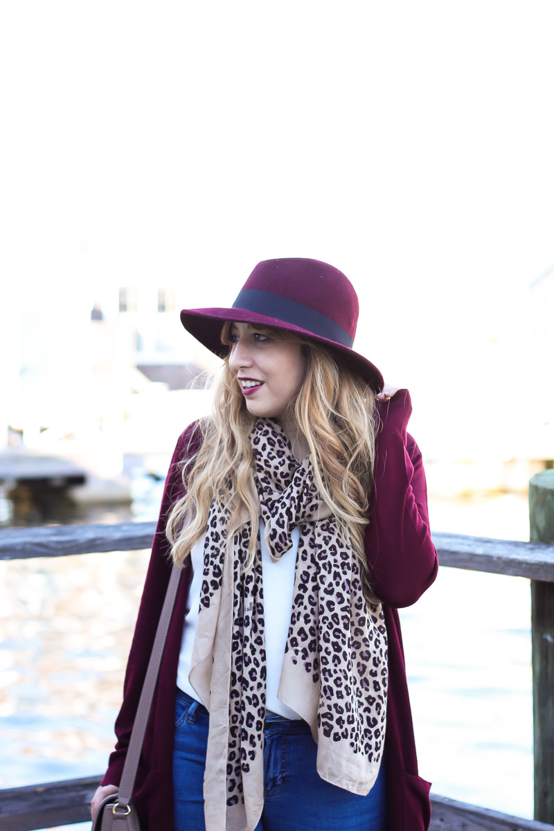 Maroon hat with leopard scarf
