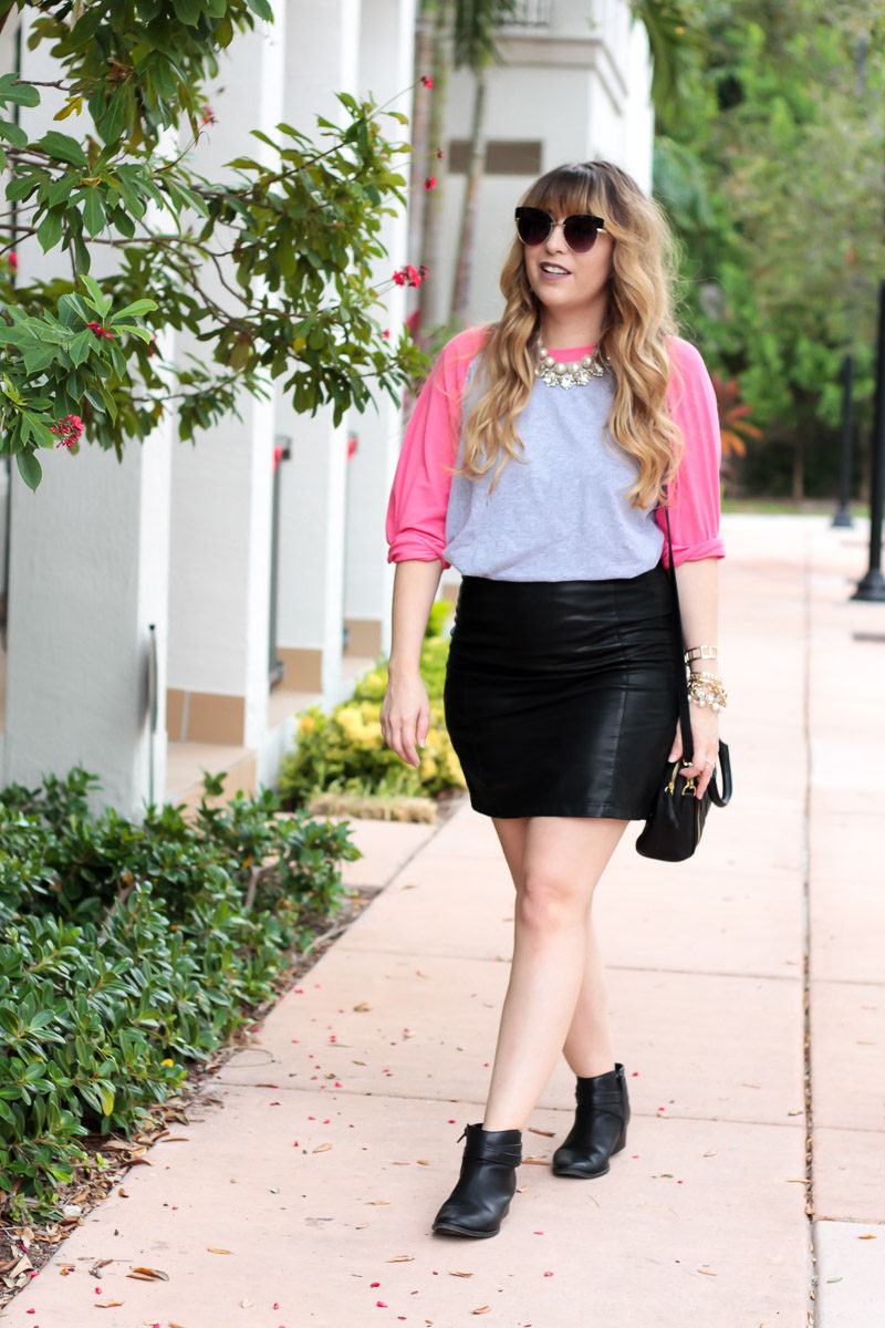 Miami fashion blogger Stephanie Pernas of A Sparkle Factor styling a raglan baseball tee with leather skirt for a chic casual outfit