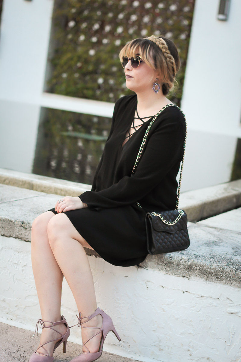 Miami fashion blogger Stephanie Pernas of A Sparkle Factor wearing a lace up shift dress with blush lace up pumps and a braided updo for a pretty fall look