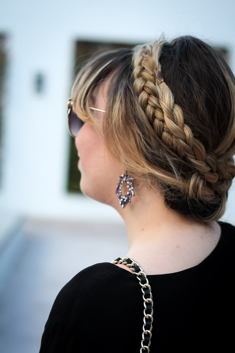 Miami fashion blogger Stephanie Pernas shares a pretty fall beauty look featuring a braided updo and statement earrings