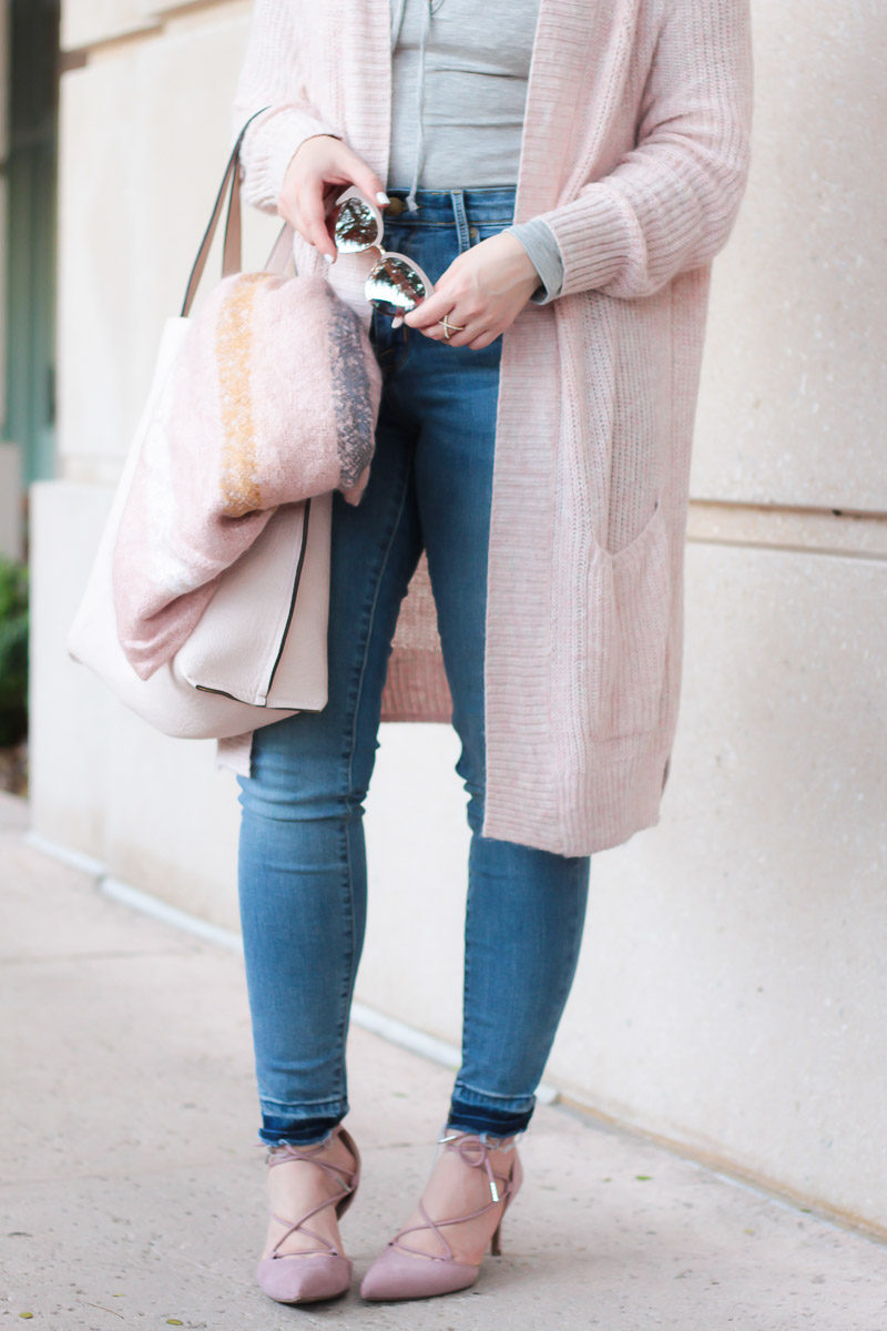 Miami fashion blogger Stephanie Pernas of A Sparkle Factor styles a blush blanket scarf with jeans and blush accessories
