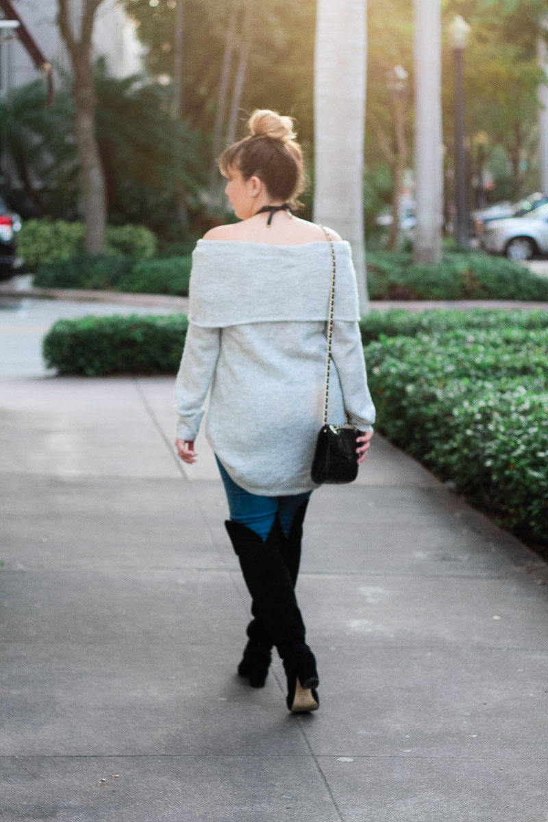 Miami fashion blogger Stephanie wearing over the knee boots with a cozy sweater and jeans for a cute fall outfit idea