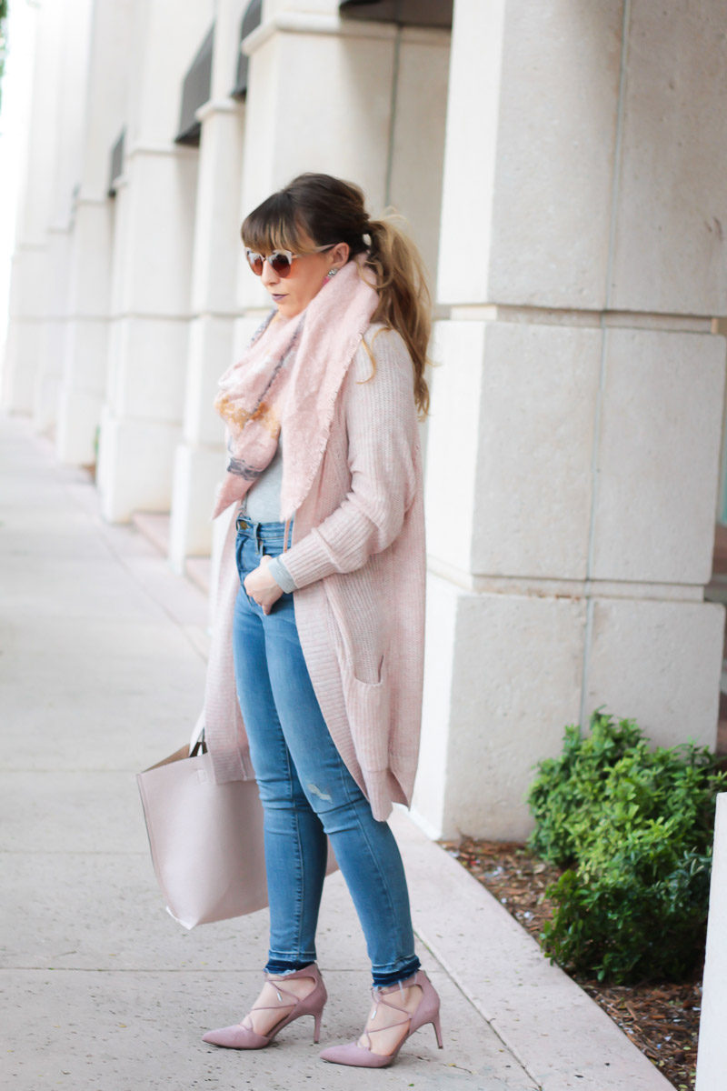 Miami fashion blogger Stephanie Pernas of A Sparkle Factor styles a blush boyfriend cardigan with blanket scarf outfit