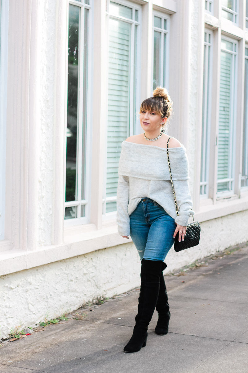 Miami fashion blogger Stephanie Pernas of A Sparkle Factor wearing an off the shoulder sweater, jeans, over the knee boots and a choker for a casual outfit idea