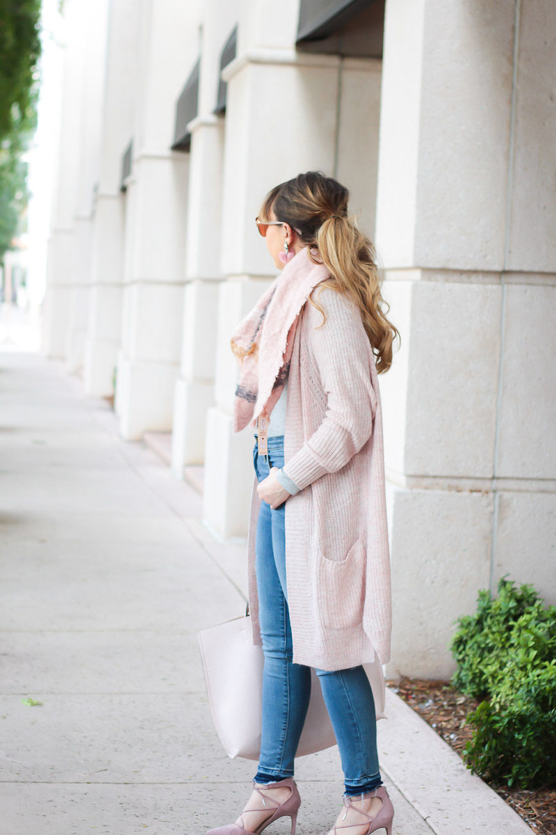 Miami fashion blogger Stephanie Pernas of A Sparkle Factor wearing a long pink cardigan and pink blanket scarf outfit