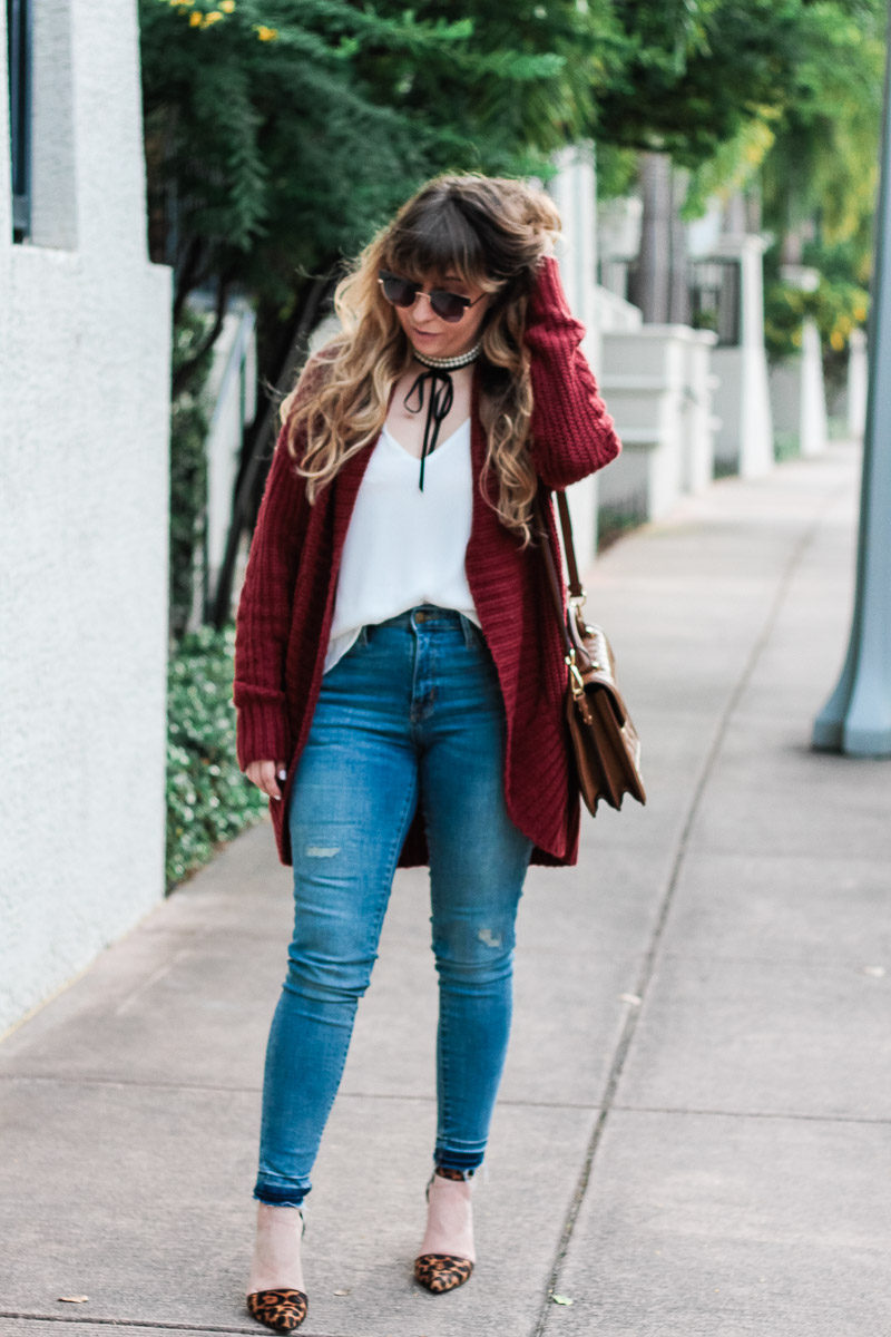 Miami fashion blogger Stephanie Pernas wearing a cable knit cardigan and leopard pumps