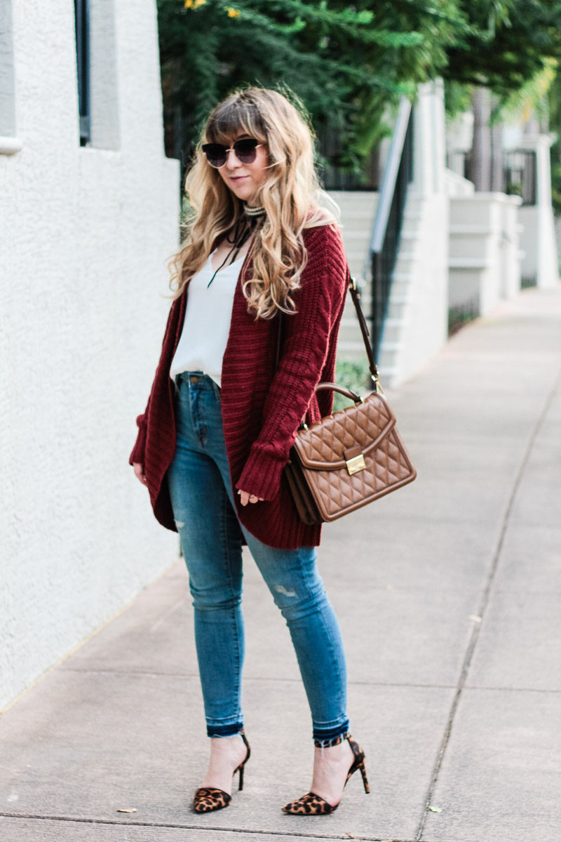 Miami fashion blogger Stephanie Pernas styles the Vera Bradley Lydia Satchel with jeans and a cardigan for a casual outfit idea