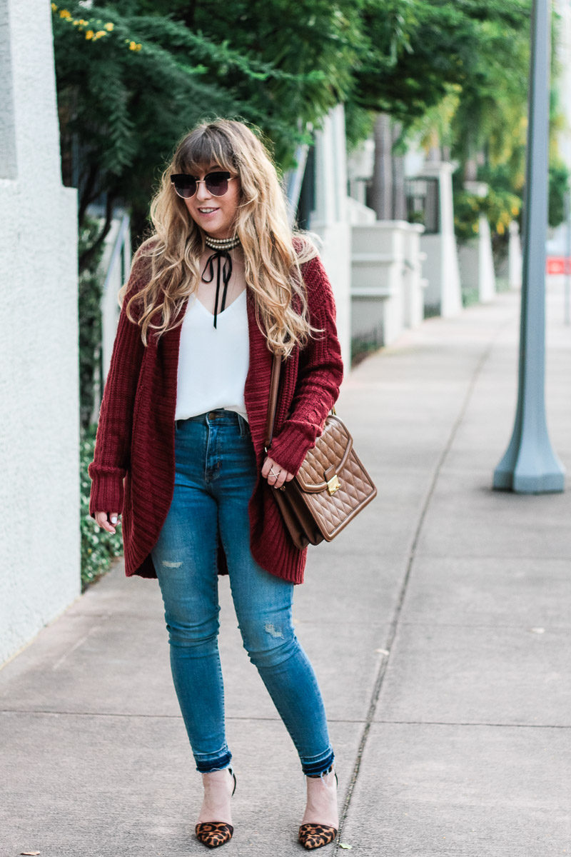 Fashion blogger wearing jeans with a boyfriend cardigan