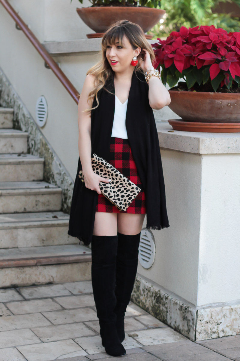 Fashion blogger wearing Sole Society Leandra boots and a plaid skirt outfit idea