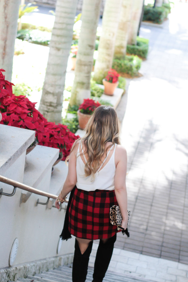 Miami fashion blogger Stephanie Pernas styles the Topshop double strap cami with a plaid skirt for a cute holiday outfit