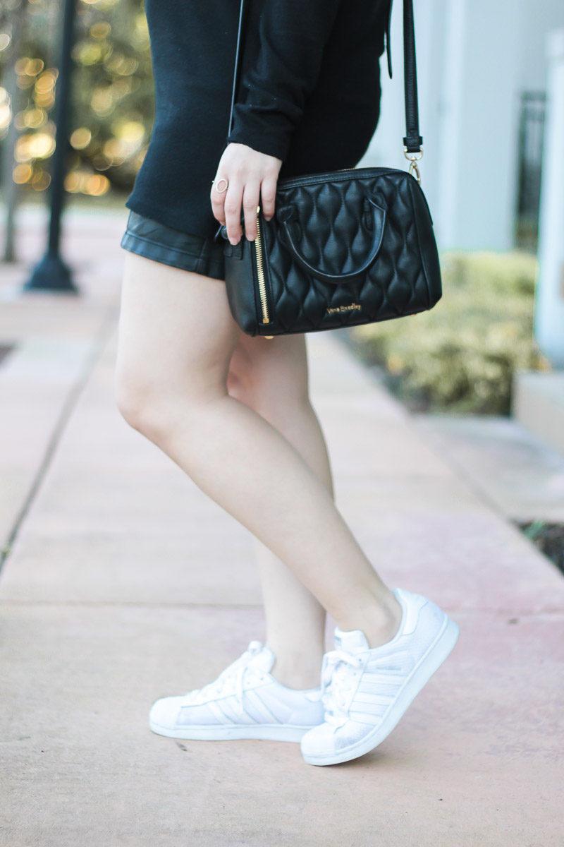 Miami fashion blogger Stephanie Pernas wearing white Adidas Superstar sneakers