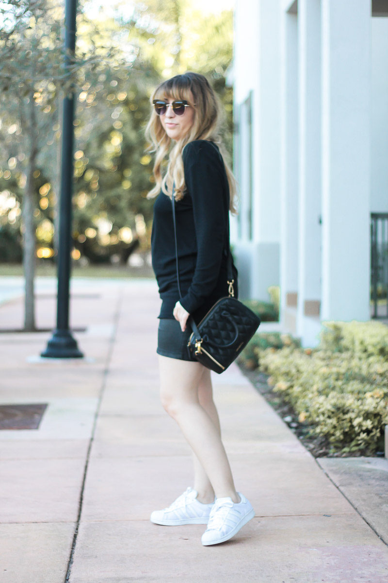 Fashion blogger Stephanie Pernas wearing an oversized sweater and Adidas Superstar sneakers for a casual outfit