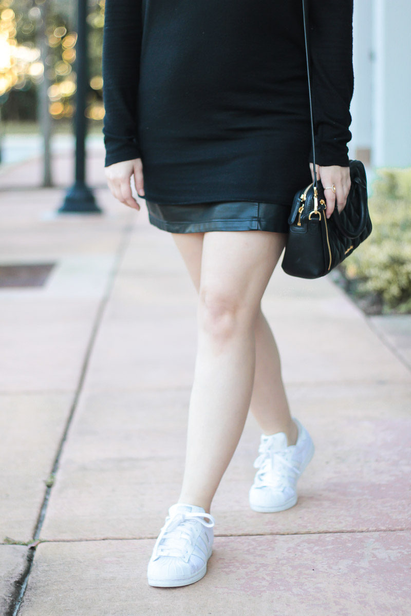 Fashion blogger Stephanie Pernas wearing white Adidas Superstar sneakers and a leather miniskirt for a cute and casual outfit