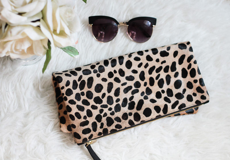 767afd1e4fcd Miami fashion blogger Stephanie Pernas shares a review of the Clare V  leopard foldover clutch ...