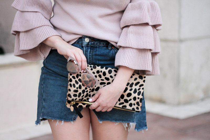 Miami fashion blogger Stephanie Pernas styles a Topshop denim skirt with a Clare V leopard clutch