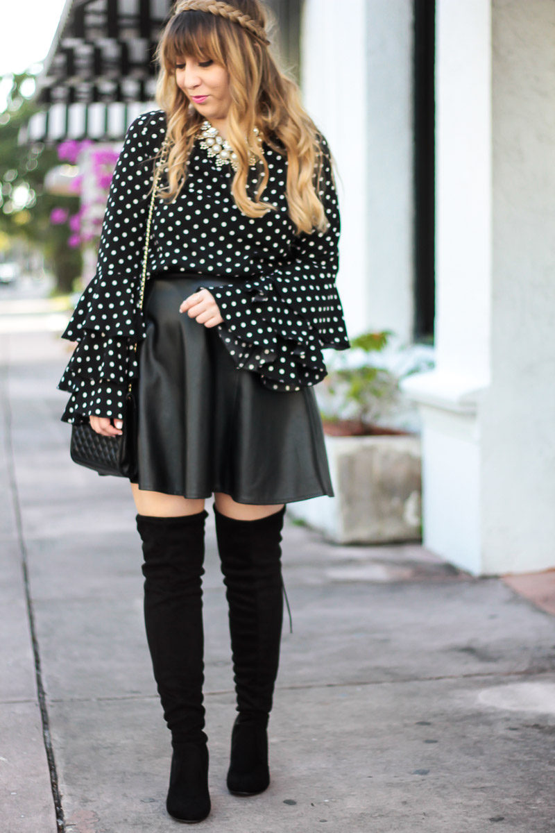 Miami fashion blogger Stephanie Pernas wearing a polka dot ruffle sleeve top and leather skirt