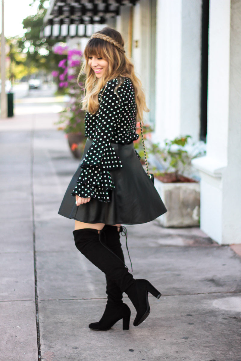 Fashion blogger Stephanie Pernas wearing over the knee boots and a leather skirt