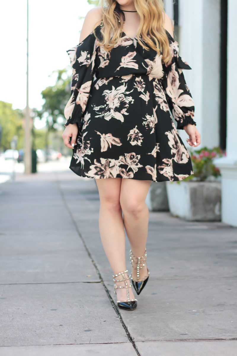 Miami fashion blogger Stephanie Pernas wearing Valentino Rockstud dupes and a floral dress