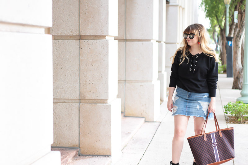 Miami fashion blogger Stephanie Pernas of A Sparkle Factor wearing a lace up sweater outfit