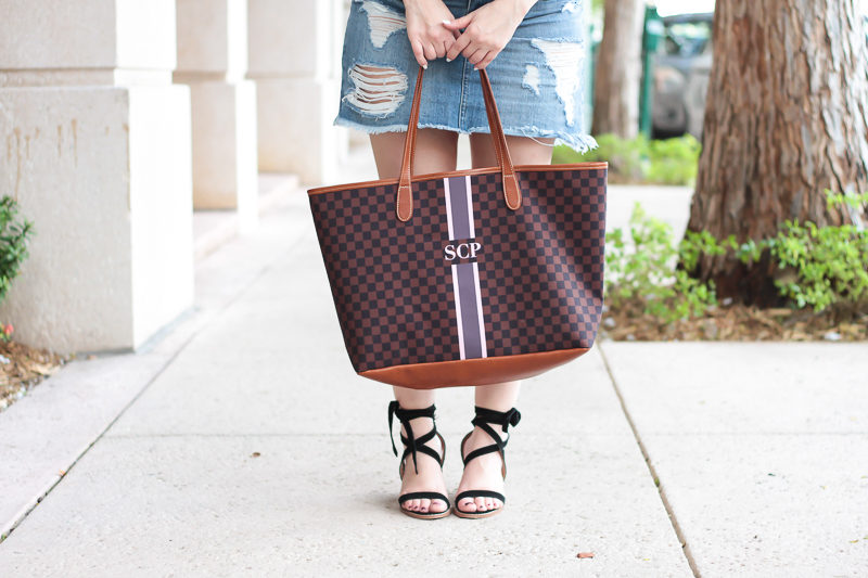 Miami fashion blogger Stephanie Pernas of A Sparkle Factor styling the Barrington Gifts St Anne monogram tote with a jean skirt and lace up heels