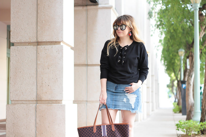 Miami fashion blogger Stephanie Pernas wearing a lace up sweater outfit for spring