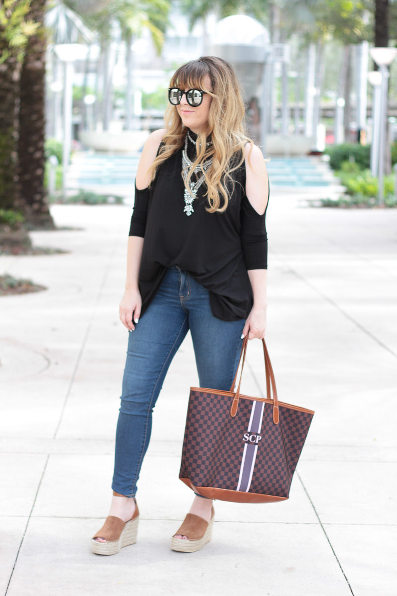 Miami fashion blogger Stephanie Pernas of A Sparkle Factor wearing a casual jeans outfit with a Barrington Gifts monogram tote