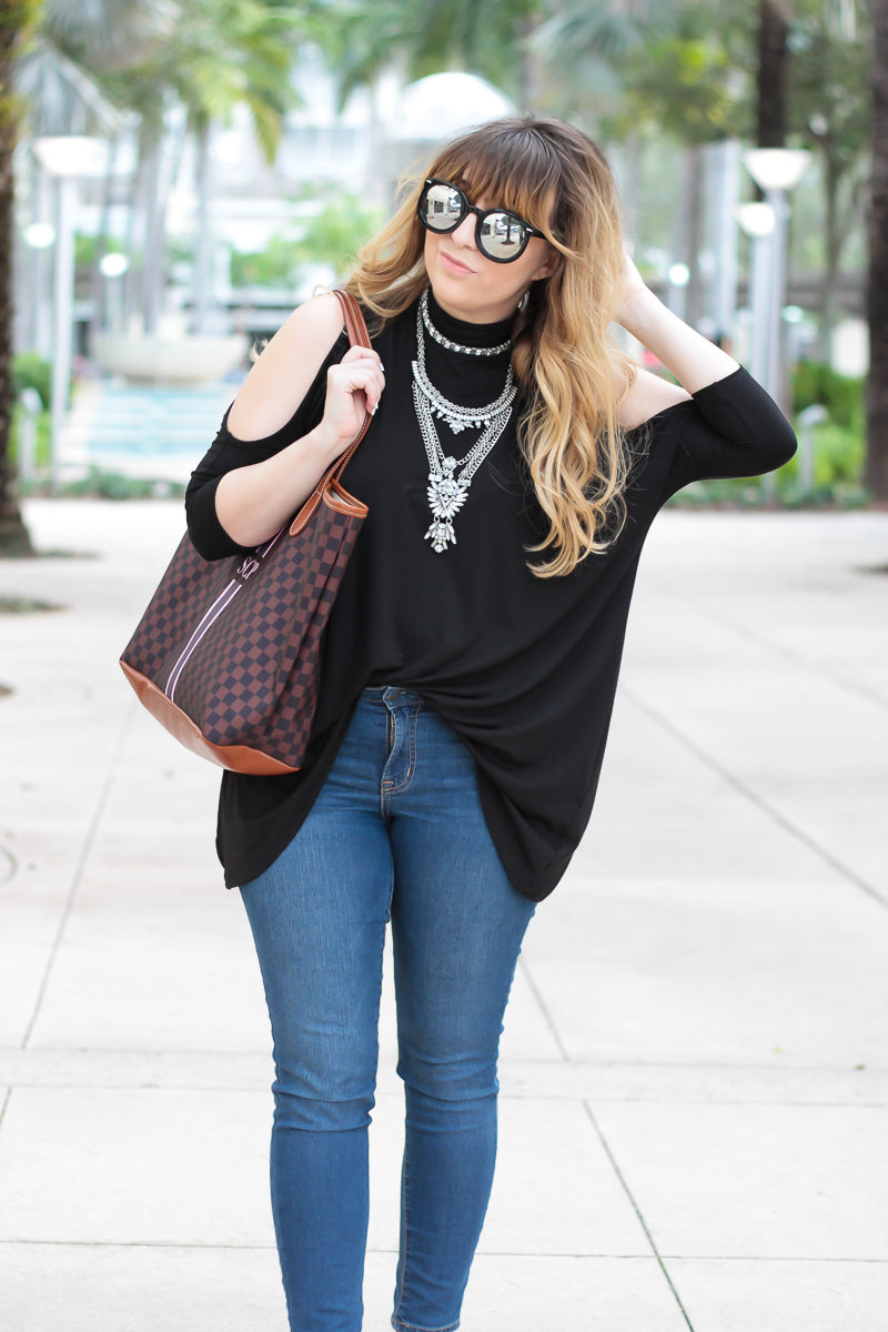 Miami fashion blogger Stephanie Pernas of A Sparkle Factor wearing a cold shoulder top with Baublebar Supernova statement necklace