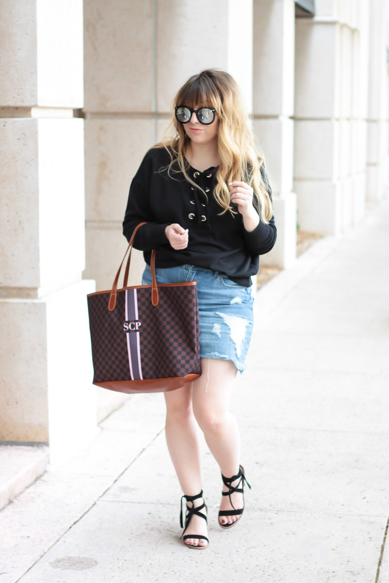 Miami fashion blogger Stephanie Pernas wearing a lace up sweater outfit idea