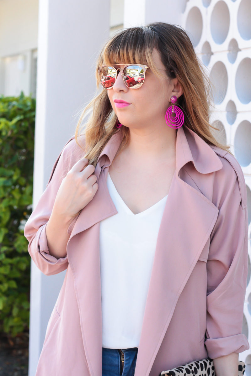 Miami fashion blogger Stephanie Pernas of A Sparkle Factor wearing Baublebar Clover Drops in hot pink with a light pink trench coat