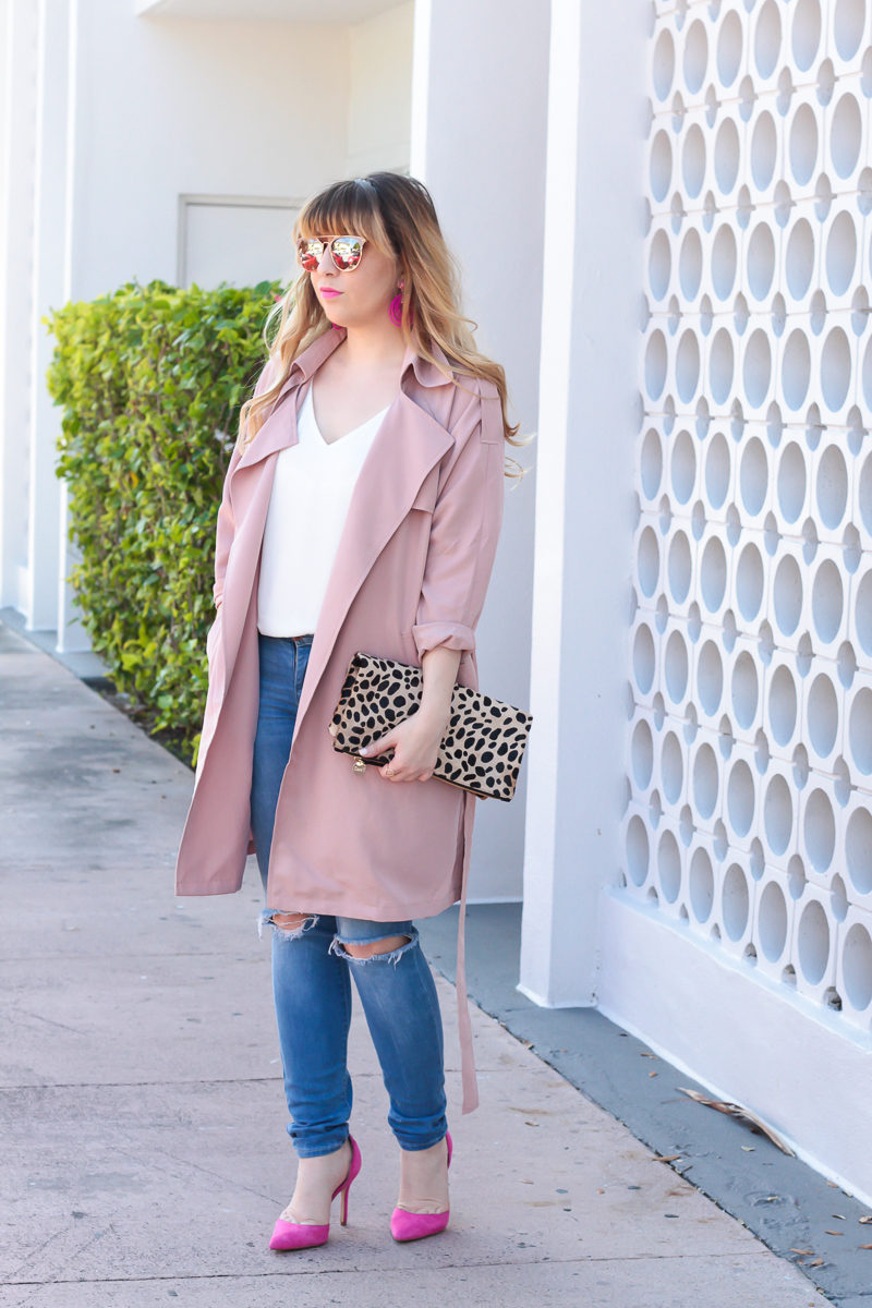Miami fashion blogger Stephanie Pernas of A Sparkle Factor wearing hot pink pumps with jeans and a pink trench
