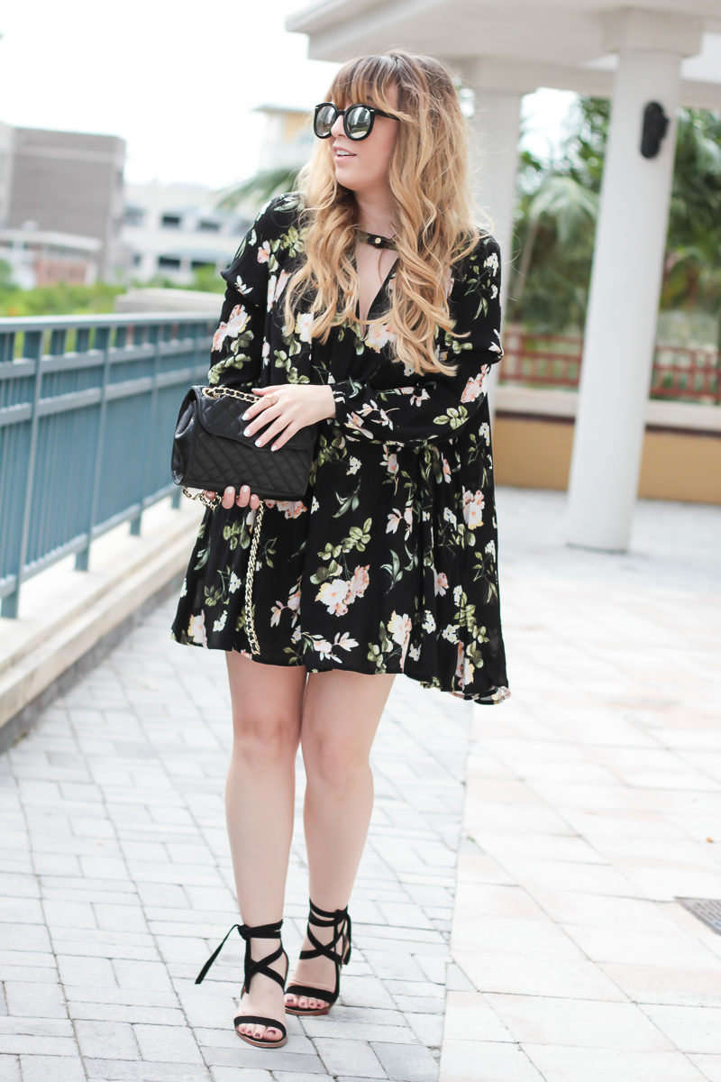 Miami fashion blogger Stephanie Pernas of A Sparkle Factor styles Chinese Laundry lace up heels with a Rebecca Minkoff Quilted Mini affair bag and a floral dress