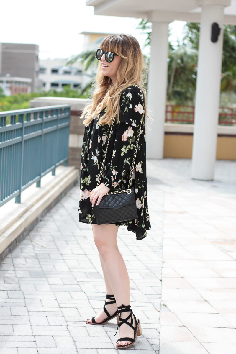 Miami fashion blogger Stephanie Pernas of A Sparkle Factor styles a spring dress outfit featuring a Shein floral lantern sleeve shift dress