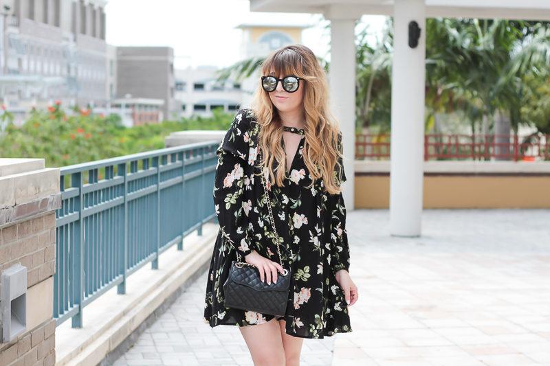 Miami fashion blogger Stephanie Pernas wearing a flowy floral dress for spring